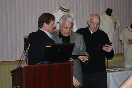 "Emcee Scott Pitoniak presents Johnny Antonelli and Joe Altobelli framed RBHS ""lifetime membership"" cards."