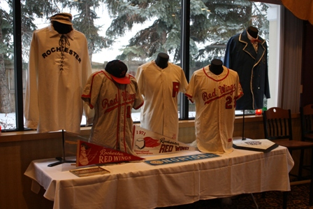 A display of Red Wings' and replica jerseys of early Rochester baseball teams served as a back drop for the events
