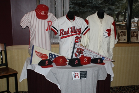 Another table displayed Red Wings jerseys, hats and an RBHS t-shirt